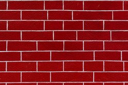 Red brick wall texture background. Bright structured stones with white stucco, different sized. Outside stone wall surface in modern urban place. Vintage maroon brick wall with grunge stonework.