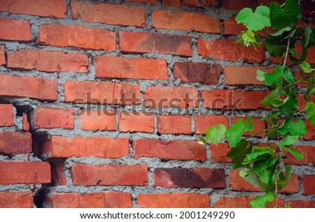red brick wall texture grunge background with vignetted corners, may use to interior design Stockfoto ©
