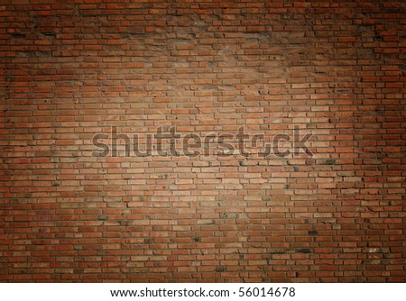red brick wall texture photo image with central light effect - stock photo