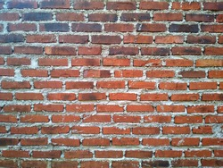 red brick wall texture vintage background. brick walls in house making
