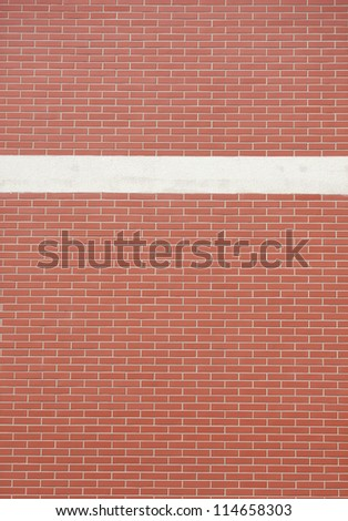 red brick wall with white line