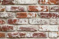 red brick wall with white paint. texture, background, design.