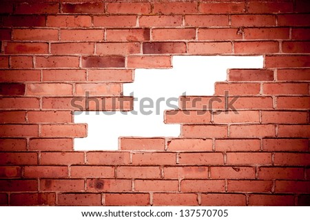 Red bricks broken wall and chuckhole background with dark vignette, brick wall surface detail abstract in horizontal orientation, digitally altered, nobody.