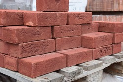 Red bricks on a pallet for sale