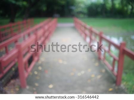 red bridge background with defocused in park