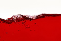 red bright liquid wave with bubbles isolated on white