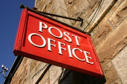 Red British Post Office sign.
