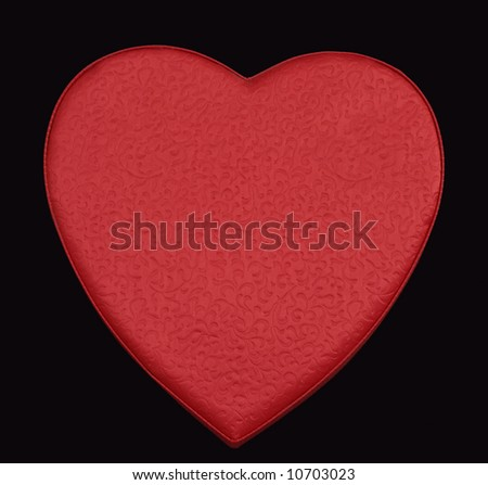 red brocade heart on black background