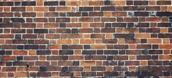 Red Brown Yellow Black Old Rustic Brick Wall Textured Background.  Retro Brickwall Wide Wallpaper. Abstract Architecture Web Banner