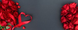 Red buds of valentines day festive roses with hearts on black, web banner format