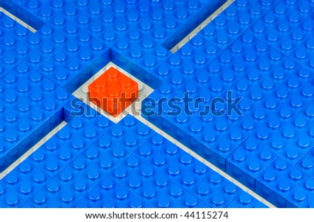 Red building block in the middle of blue one