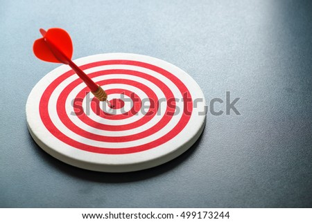 red bullseye dart with red...