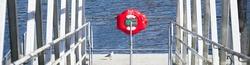 Red buoy life safety ring at boat marina