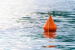 Red buoy on the sea waves background