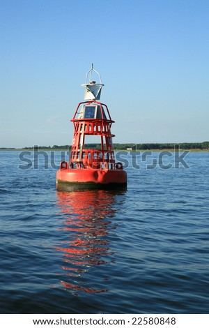 Red buoy on water. Water signal. Light sign.