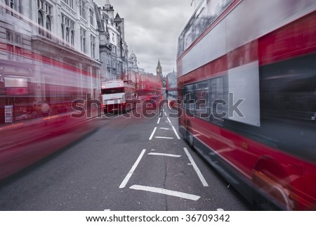 Red buses in London with Big Ben in the background