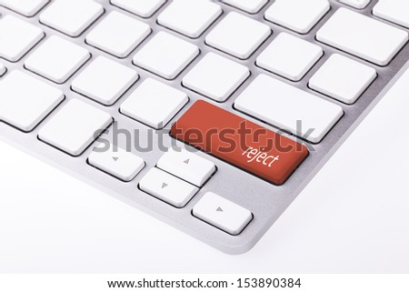 Red button with word 'reject' on keyboard