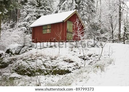 Red cabin in winter woods