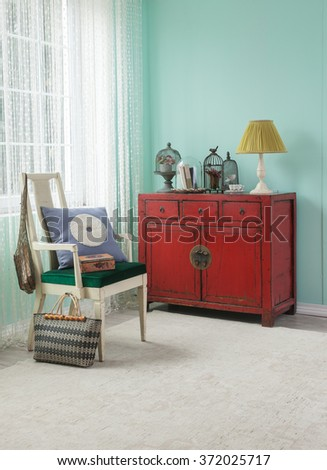 red cabinet asian living room...