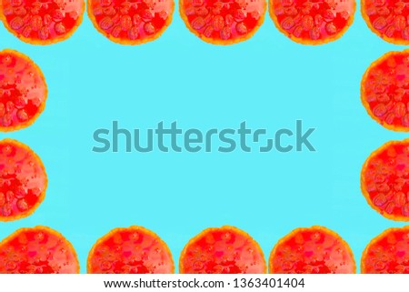 Red cake with strawberries on a turquoise background. Frame for picture of pies.