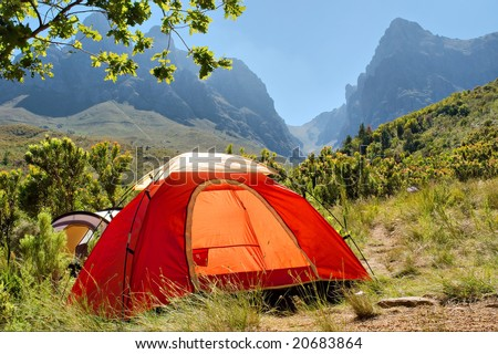 Red camping tent in misty mountains. Shot in Hottentots-Holland Mountains nature reserve, near Somerset West/Cape Town, Western Cape, South Africa.