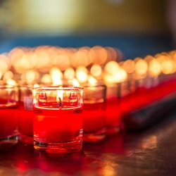 Red candle is kindle a fire in glass