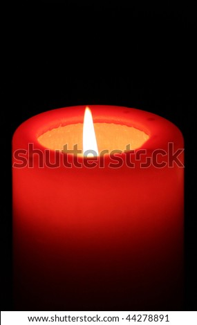 red candle with black background