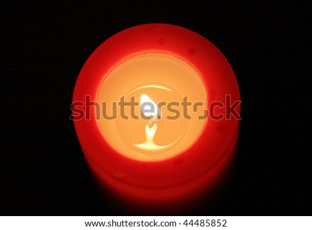 red candle with black background (view from top)