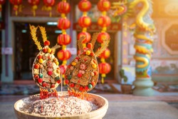 Red candles and burning incense sticks Paper gold with the Chinese alphabet Blessings written on it Is a Fortune blessing compliment for pay respect to god in Chinese New Year day at a Chinese shrine