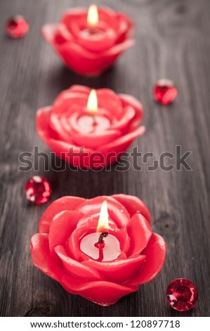 Red candles on vintage wooden board