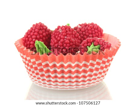 red candy raspberries isolated on white