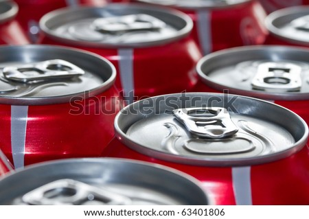 Red Cans of soft drink - stock photo