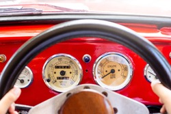 Red car cockpit of classic car.