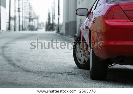 Red car detail. Makes for a good design element. - stock photo