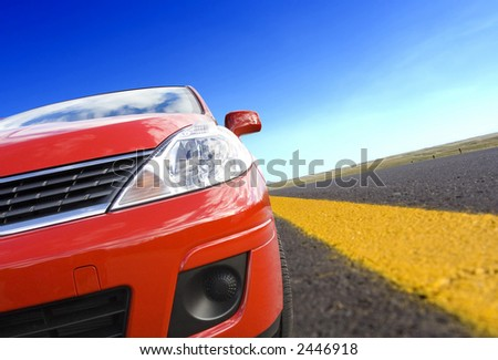Red car on a  road with yellow line(tilted)