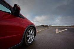 Red car on asphalt road for trip.