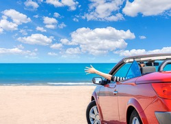 Red car on the beach. Vacation and freedom concept.
