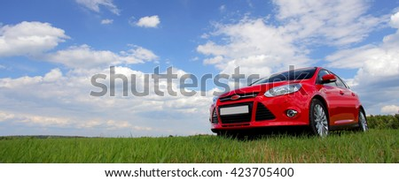 red car on the green grass...
