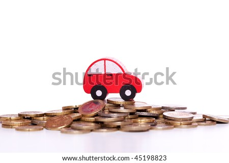 red car over a lot of golden coins (isolated on white)
