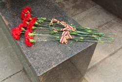 Red carnation for commemoration days.