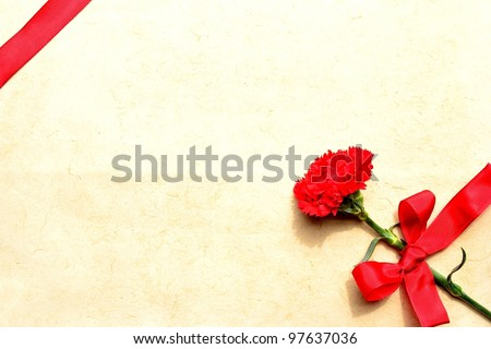 Red carnation with ribbon.Mothers day image.