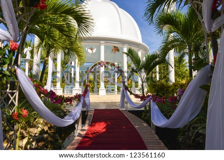 red carpet before the wedding ceremony in a tropical scenery - stock