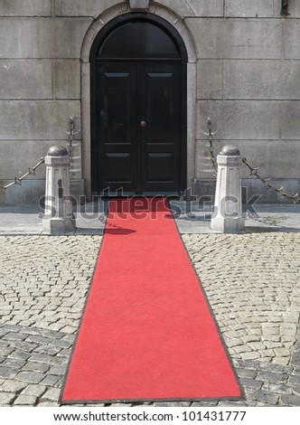 Red carpet leading to the door of a European marriage bureau