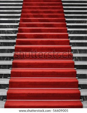 Red carpet on marble stairway