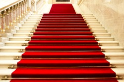 Red carpet on the stairs in a luxury interior