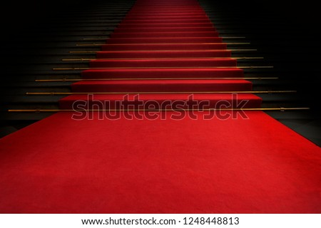 Red carpet on the stairs on a dark background. The path to glory, victory and success #1248448813