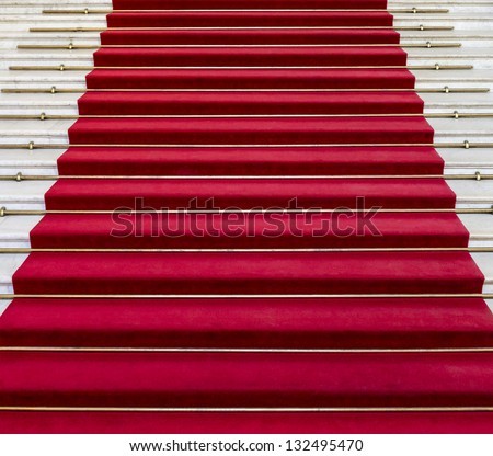 Red carpet on white marble stairs - stock photo