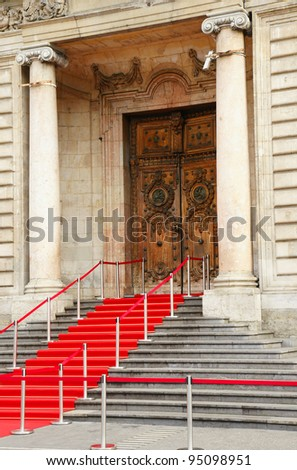 Red carpet over staircase for government officials or celebrities leading to beautiful historical stone building in Europe, hotel de ville, Lyon, France.