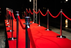 Red carpet with barriers and red ropes.