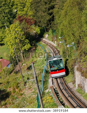Red Carriage of the Funicular Railway in Bergen, Norway, climbing Mount Floyen.